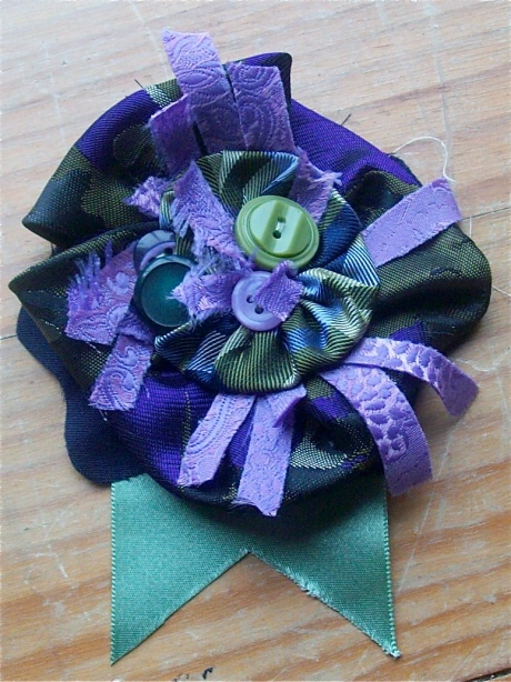 Purple and green rosette made from recycled ties