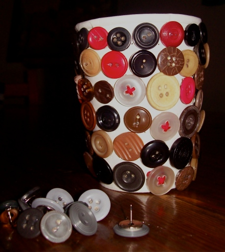Push buttons.... beautifully displayed on a reclaimed coffee cup. 3 yr old thought of the idea, and 9 yr old executed it.