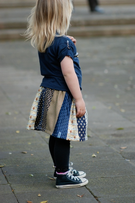 "3 year old in ""duck duck goose"" skirt and t-shirt"