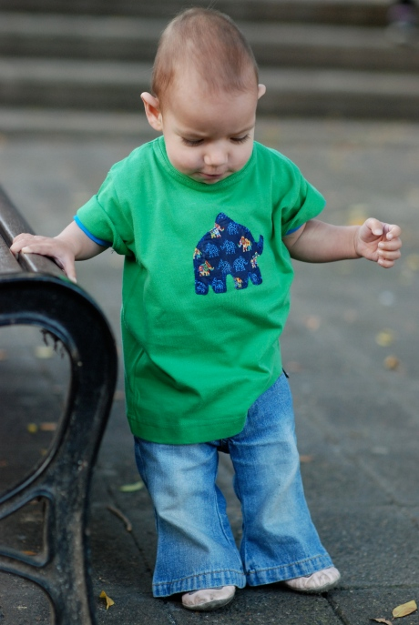C in green elephant t-shirt