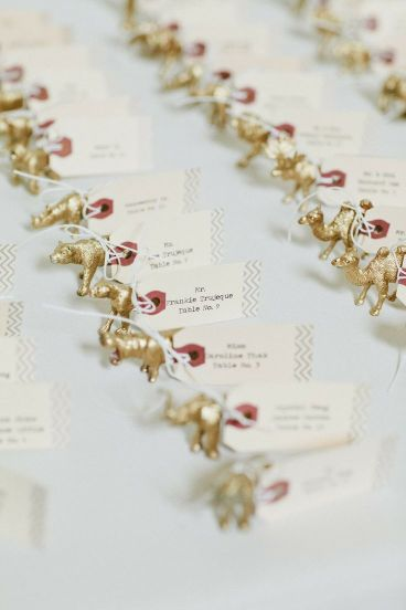 Gold Spray painted animals (or possibly nativity characters) with paper luggage tags attached. Image from Style Me Pretty.