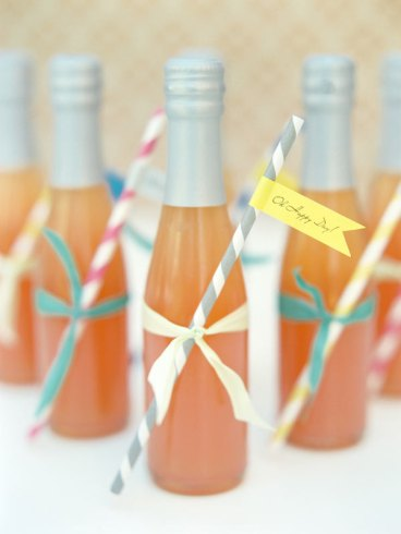 Carnival Straws on Bottled drinks with tags. Source: Ruffled.
